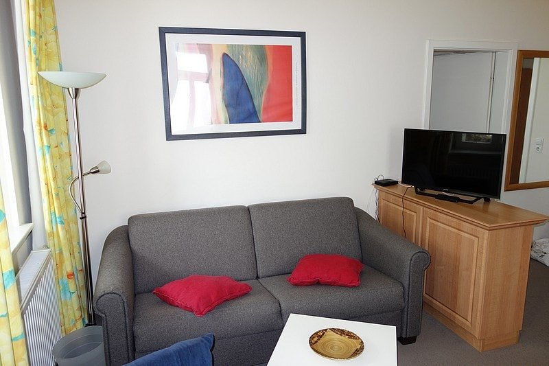 Wohnzimmer und Flach-TV Wohnung 1